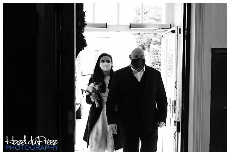 bride and groom entering Leatherhead Register Office wearing masks